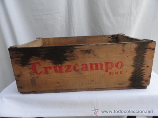antigua caja de madera cruzcampo