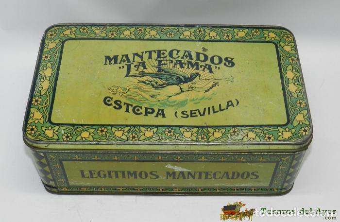 ANTIGUA CAJA DE HOJALATA MANTECADOS LA FAMA ESTEPA SEVILLA, ALFAJORES, POLVORONES, ROSCOS DE VINO, M (Coleccionismo - Cajas y Cajitas Metálicas)