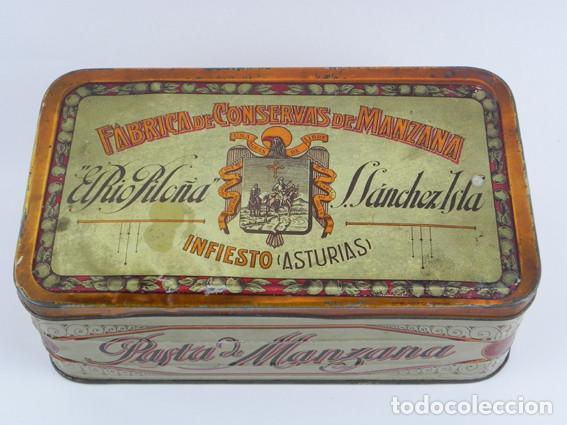 ANTIGUA CAJA DE HOJALATA LITOGRAFIADA DE INFIESTO ASTURIAS, EL RIO PILOÑA. FABRICA DE CONSERVAS DE M (Coleccionismo - Cajas y Cajitas Metálicas)