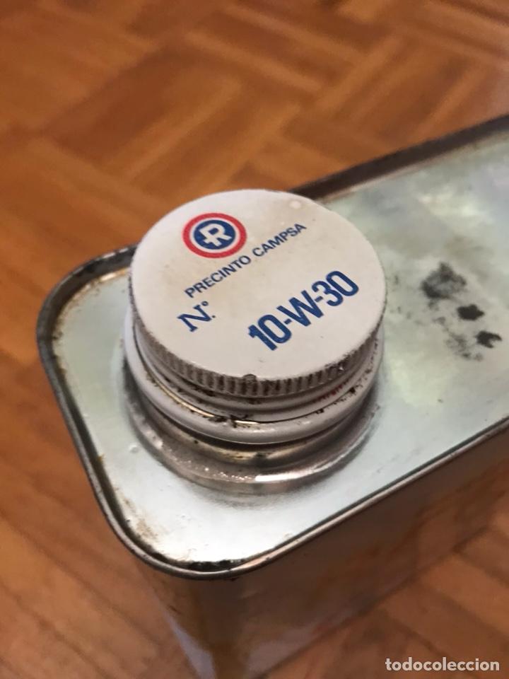 Cajas y cajitas metálicas: Lata Repsol 2 litros multigrado HD años 80 - Foto 2 - 134084194