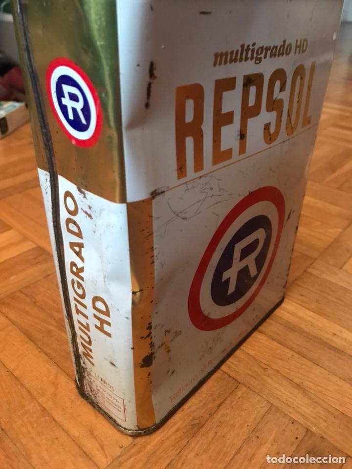 Cajas y cajitas metálicas: Lata Repsol 2 litros multigrado HD años 80 - Foto 3 - 134084194
