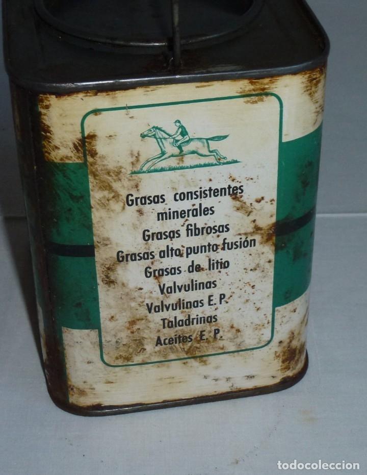 Cajas y cajitas metálicas: Antigua lata de Lubricantes Jockey. - Foto 3 - 178672186