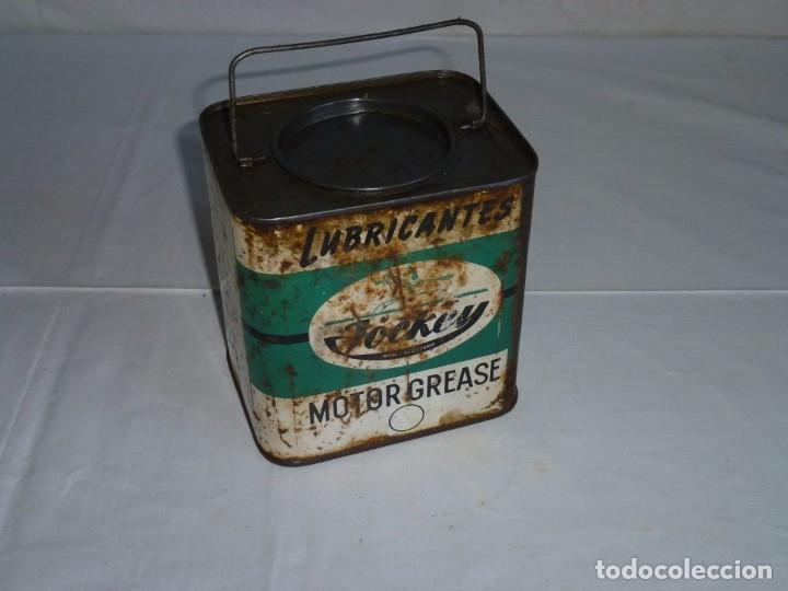 Cajas y cajitas metálicas: Antigua lata de Lubricantes Jockey. - Foto 4 - 178672186