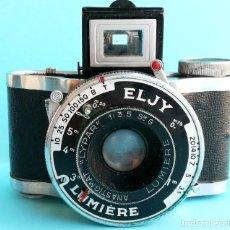 Cámara de fotos: ANTIGUA CAMARA FOTOGRAFICA EN MINIATURA,MARCA ELJY LUMIERE,FRANCIA,AÑO 1949,FUNDA EPOCA,FOTOGRAFIA. Lote 94355446