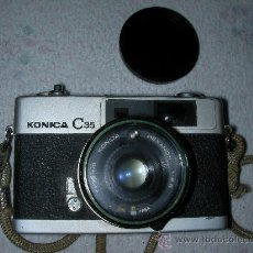 Cámara de fotos: ANTIGUA CAMARA FOTOGRAFICA 2 KONICA C35 . Lote 24915579