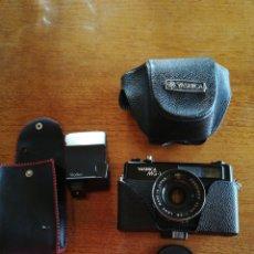 Cámara de fotos - Yashica MG 1 acabado en negro, funda original, flash rollei - 131721910