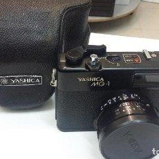 Cámara de fotos: CAMARA FOTOGRAFICA ANALOGICA YASHICA MG-1 CON FUNDA Y CORREA. Lote 152219258