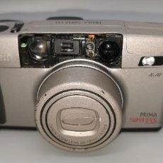 Cámara de fotos: CAMARA CANON PRIMA SUPER 135. FALTA EMBELLECEDOR DONDE ESTA LAS LENTES. Lote 243971935