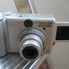 Cámara de fotos: CANON POWER SHOT A95 AIAF CON PANTALLA EXTRAIBLE Y REVERSIBLE. Lote 29263877