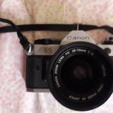 Cámara de fotos: CÁMARA CANON AE1 PROGRAM + OBJETIVO 35-70 CANON. Lote 171794638