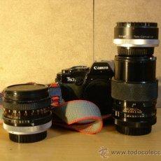 Cámara de fotos - Canon T60 + Canon 50mm 1:1.8 + Teleobjetivo Soligor 135 mm 1:2.8 + Duplicador Vivitar 2X - Funciona - 39227629
