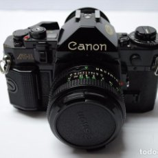 Cámara de fotos: CAMARA CANON A1 - CON VARIOS ACESORIOS - AÑO 1971. Lote 73696279