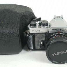 Cámara de fotos: CAMARA FOTOGRÁFICA. YASHICA FX-7. 35 MM. FUNDA ORIGINAL. CIRCA 1980. . Lote 136594654