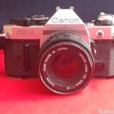 Cámara de fotos: CAMARA CANON AE-F LENS FD 50 MM 1:1.8. LE FALTA LA TAPA DEL BASE Y UN DEFECTO EN OBJETIVO VER FOTOS. Lote 210843136
