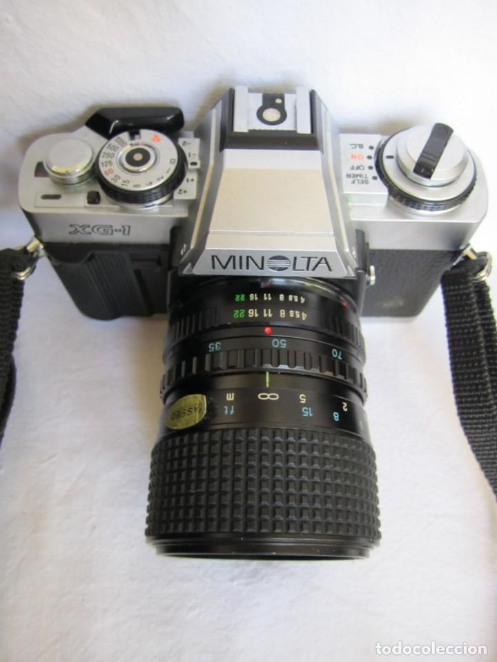 CÁMARA MINOLTA XG-1, OBJETIVO 35-70 MM., FLASH OSRAM V-250 STUDIO, MALETÍN Y MANUAL EN ESPAÑOL (Cámaras Fotográficas - Réflex (no autofoco))