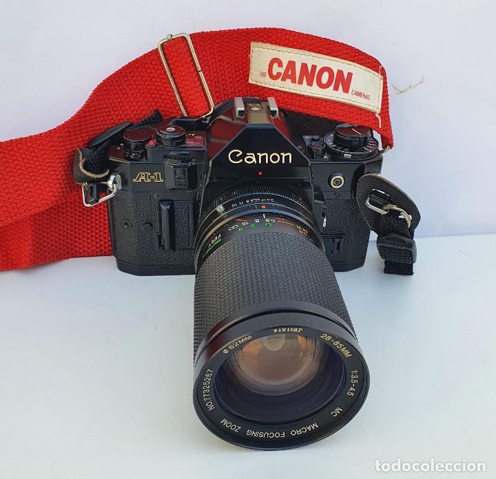CANON A1 CON OBJETIVO FD VIVITAR (Cámaras Fotográficas - Réflex (no autofoco))
