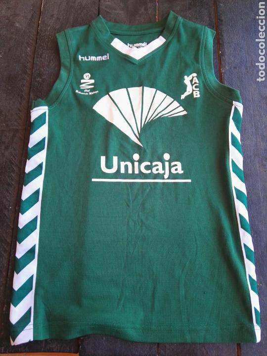 CAMISETA UNICAJA BALONCESTO NIÑO HUMMELS (Coleccionismo Deportivo - Ropa y Complementos - Camisetas otros Deportes)
