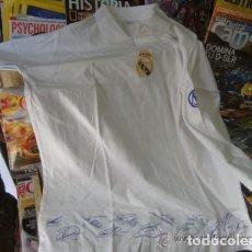 Coleccionismo deportivo: CAMISETA CENTENARIO REAL MADRID - FIRMADA POR LA PLANTILLA - TALLA L - NUEVA Y PRECINTADA DE KIOSKO. Lote 107501735