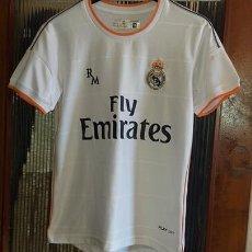 Coleccionismo deportivo: CAMISETA REAL MADRID PRODUCTO OFICIAL TALLA 10. Lote 156700798