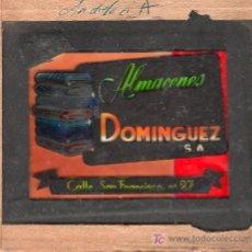 Carteles: PUBLICIDAD. CRISTAL PUBLICITARIO DE PROYECTOR DE CINE. ALMACENES DOMINGUEZ.. Lote 18817849