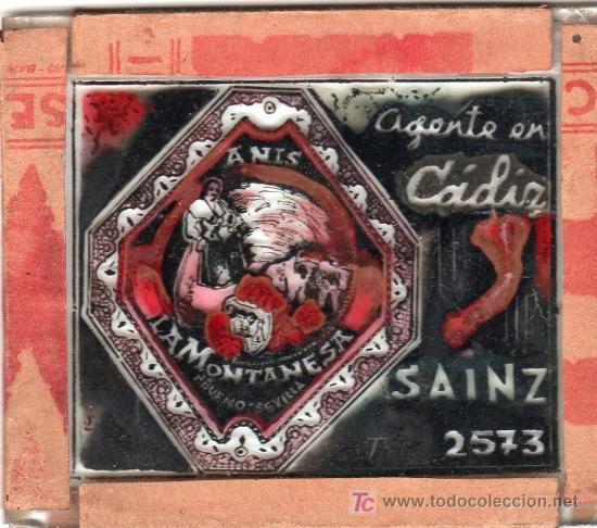 PUBLICIDAD. CRISTAL PUBLICITARIO DE PROYECTOR DE CINE. AGENTE EN CADIZ SAINZ 2573. (Coleccionismo - Carteles y Chapas Esmaltadas y Litografiadas)