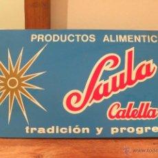 Affissi: ANTIGUO CARTEL DE CHAPA PRODUCTOS SAULA CALELLA VINTAGE MEDIADOS S.XX DOBLE CARA. Lote 47257635