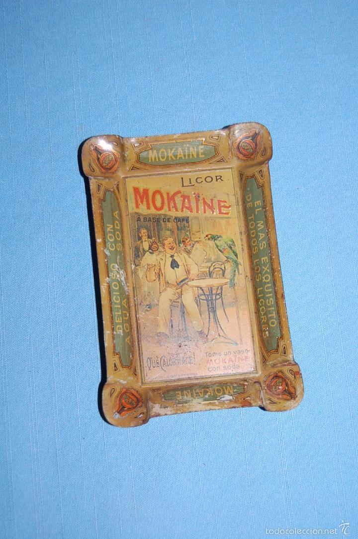 CENICERO PUBLICIDAD EN METAL DE 12,5 CM X 8,5 CM LICOR MOKAINE (Coleccionismo - Carteles y Chapas Esmaltadas y Litografiadas)