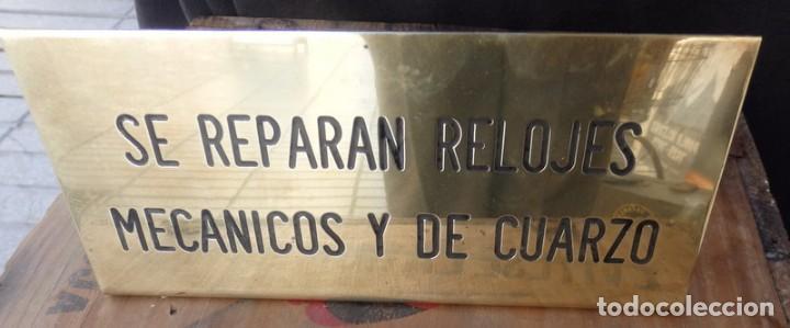 ANTIGUA CHAPA DE RELOJERO, SE ARREGLAN RELOJES MECANICOS Y DE CUARZO,20X9 CMS (Coleccionismo - Carteles y Chapas Esmaltadas y Litografiadas)