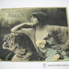 Carteles Publicitarios: CARTEL PUBLICIDAD ANIS X CON BONITA FOTOGRAFIA DE MUJER Y TIGRE . 28 X 22 CMS . . Lote 17927158