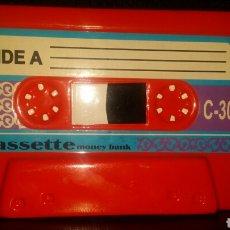 Casetes antiguos: CINTA DE CASETTE HUCHA ROJA CASETE RADIOCASETTE RADIOCASETE. Lote 152065762