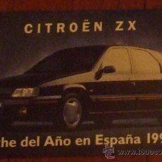 Coches y Motocicletas: CITROËN ZX COCHE DEL AÑO EN ESPAÑA 1992.LOTE DE 2 PEGATINAS 12X7,5CM. Lote 17128704