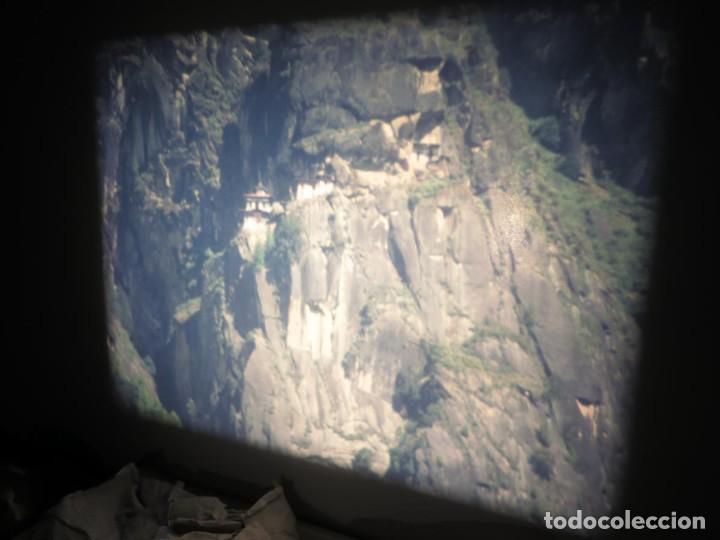 Cine: ANTIGUA BOBINA PELÍCULA-FILMACIONESAMATEUR -BOUTHAN TERMINÉ Á THIMPHU-AÑOS 80-16 MM, RETRO VINTAGE - Foto 6 - 194668903