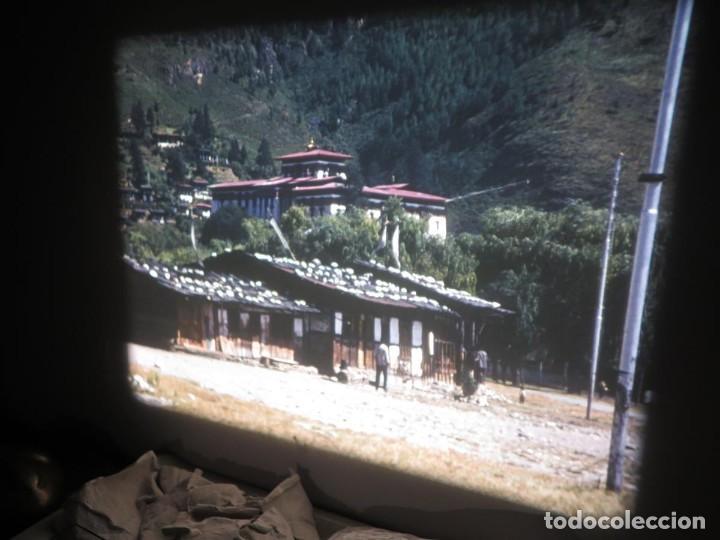 Cine: ANTIGUA BOBINA PELÍCULA-FILMACIONESAMATEUR -BOUTHAN TERMINÉ Á THIMPHU-AÑOS 80-16 MM, RETRO VINTAGE - Foto 16 - 194668903