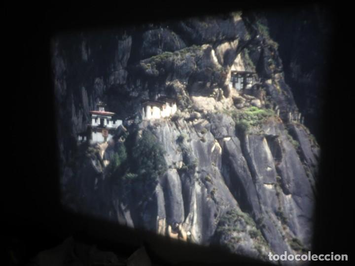 Cine: ANTIGUA BOBINA PELÍCULA-FILMACIONESAMATEUR -BOUTHAN TERMINÉ Á THIMPHU-AÑOS 80-16 MM, RETRO VINTAGE - Foto 20 - 194668903