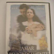 Cine: ANGELINA JOLIE AMAR PELIGROSAMENTE DVD PRECINTADO COMPRA 2 DVD'S Y PAGA LOS G.ENVIO DE UNO!!!. Lote 35427496