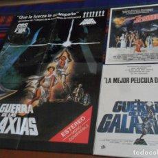 Cine: CARTEL LA GUERRA DE LAS GALAXIAS LANZAMIENTO VIDEO 1984 GUÍA LOS 7 MAGNÍFICOS DEL ESPACIO CON REGALO. Lote 173499567