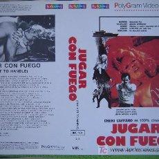 Cine: JUGAR CON FUEGO- CARATULA DE VIDEO TAMAÑO GRANDE - CHERI CAFFARO. Lote 20507177