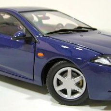 Coches a escala: FORD COUGAR 1998 ESCALA 1/18 DE ACTION PERFORMANCE. Lote 195232620