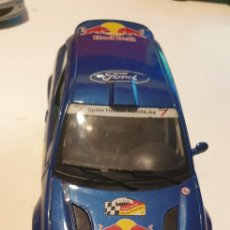 Auto in scala: FORD FOCUS RALLY RED BULL SCALA 1/18 BURAGO. Lote 246341235