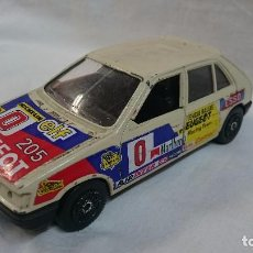 Coches a escala: PEUGEOT 205 GT GUILOY 1:24?. Lote 64003775