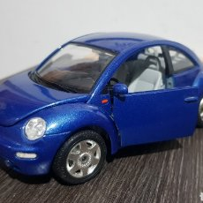 Coches a escala: VW NEW BEETLE BURAGO 1/24. Lote 230918135