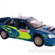 Coches a escala: COCHE RALLY SUBARU IMPREZA WRC -PETTER SOLBERG /FIA WORLD RALLY GALES 2003 (ESC. 1:24) IXO RALLYE N6. Lote 223898976
