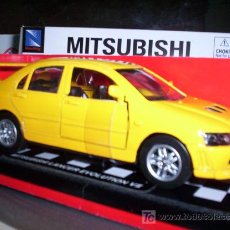 Coches a escala: MITSUBISHI LANCER EVO VII E NEW RAY DE METAL ESC. 1,32. Lote 25426043