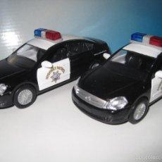 Coches a escala: LOTE DE 2 COCHES DE LA POLICIA AMERICANA NUEVOS EN CAJA ESCALA 1:32. Lote 58679728