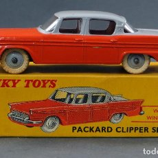 Coches a escala: PACKARD CLIPPER SEDAN CRISTALES DINKY TOYS MADE IN ENGLAND CON CAJA 180 1/43 AÑOS 50. Lote 120420083