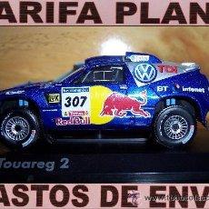 Coches a escala: VW TUAREG DAKAR 2006 C.SAINZ- A.SCHULZ ESCALA 1:43 DE NOREV EN CAJA. Lote 26672428