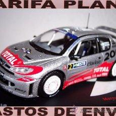 Coches a escala: PEUGEOT 206 WRC RALLY DE FINLANDIA 2002 MARCUS GRONHOLM -TIMO RAUTIAINEN ESCALA 1:43 DE ALTAYA EN. Lote 30645319