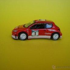 Coches a escala: PEUGEOT 206 WRC DE IXO ALTAYA 1,43. Lote 42255147