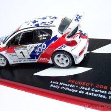 Coches a escala: PEUGEOT 206 WRC LUIS MONZON 1/43 NUESTROS CAMPEONES DE RALLY. Lote 142037796