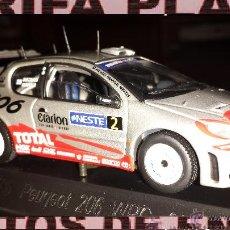 Coches a escala: PEUGEOT 206 WRC Nº2 RALLYE GRONHOLM ESCALA 1:43 DE SOLIDO EN SU CAJA. Lote 46211492